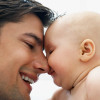 Happy Father with Baby Girl --- Image by © Simon Jarratt/Corbis